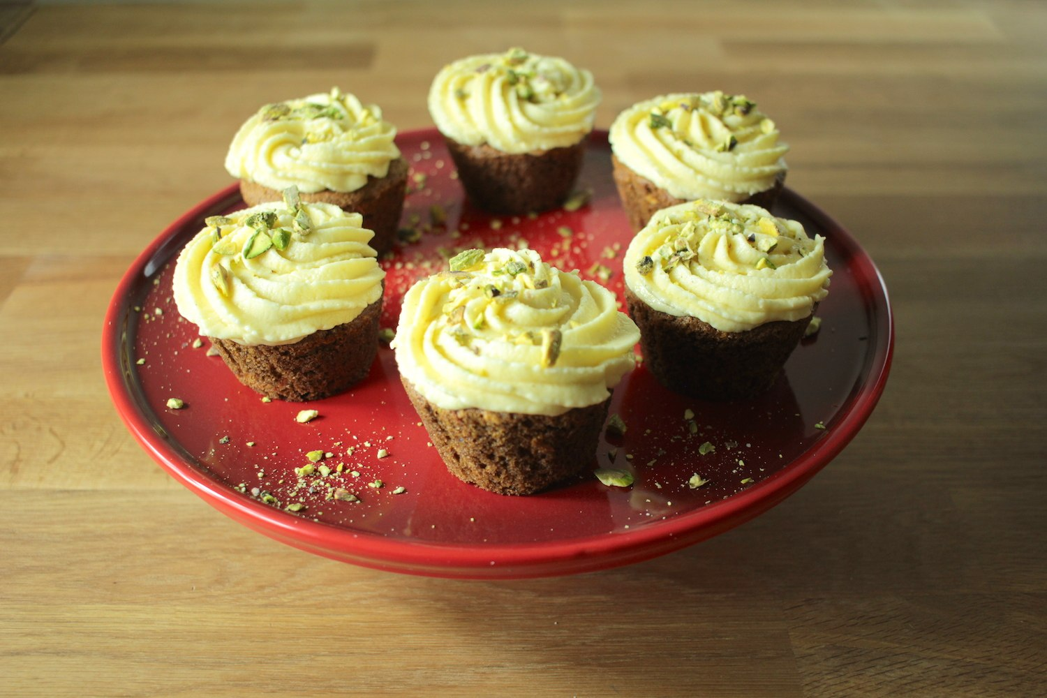 Carrot and Pistachio Muffins with White Chocolate Frosting Recipe - Globe Scoffers | globescoffers.com