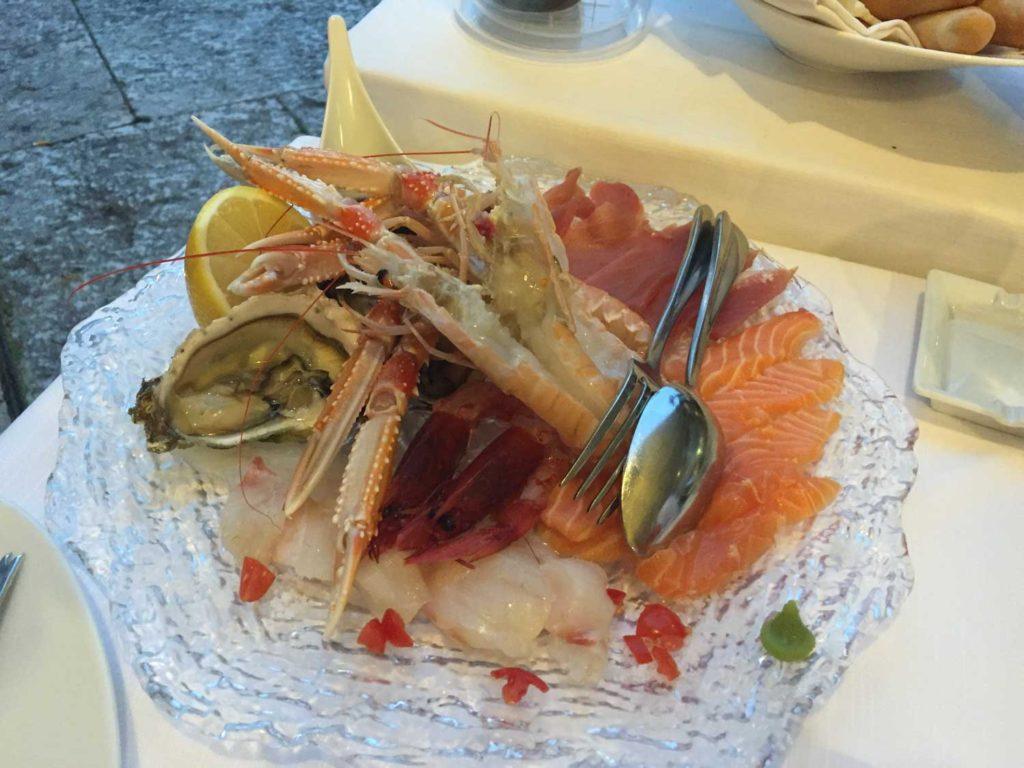 Raw fish and shell fish.