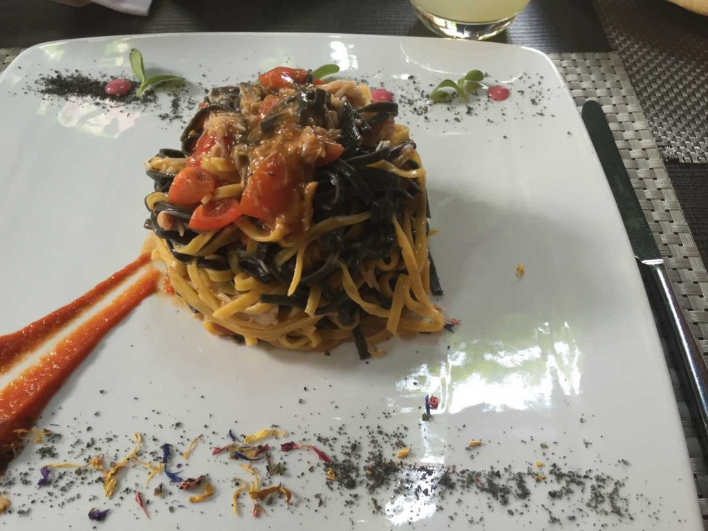 Black and white pasta,with crab and fresh tomato.