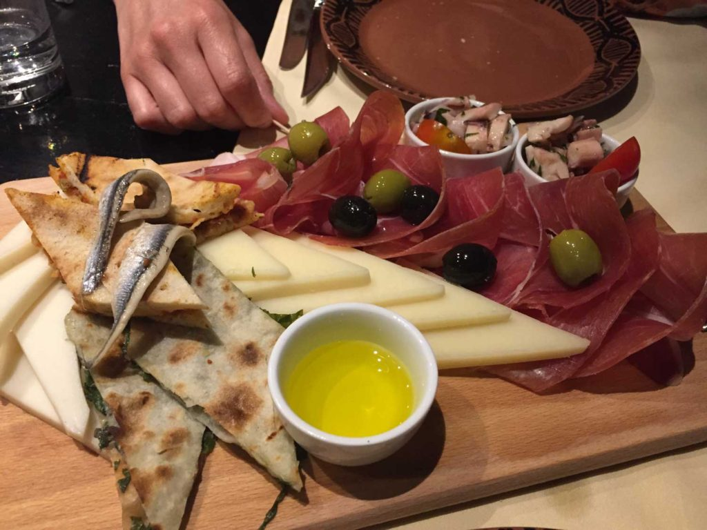 Platter of meats,fish and cheese.