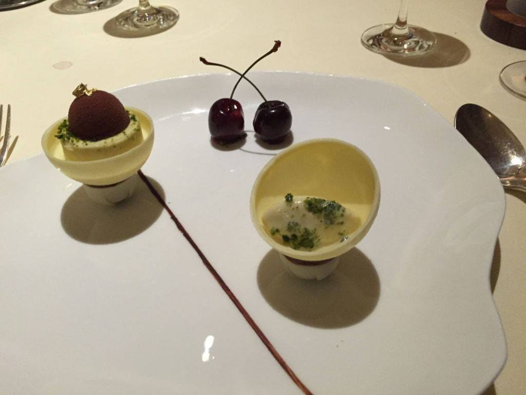 My desert. White chocolate sphere Filled with a pistachio kirsch mousse and compote of cherries
