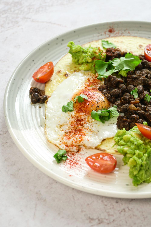 Spicy Bean and Fried Egg Tostada Recipe - Globe Scoffers | globescoffers.com